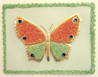 ©2012 Lindsay Obermeyer Scrapping butterfly with glitter